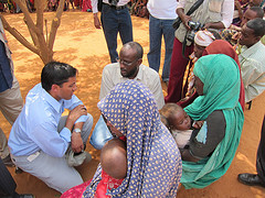 USAID Administrator Shah listens to the story of a young Somali woman who walked for 33 days with her children to reach Dadaab camp in Kenya.