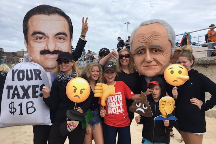 Photo: Protestors wear masks of Gautam Adani and Australian PM Malcolm Turnbull, depicting the unpopular billion dollar government subsidy. Credit: Stop Adani Alliance