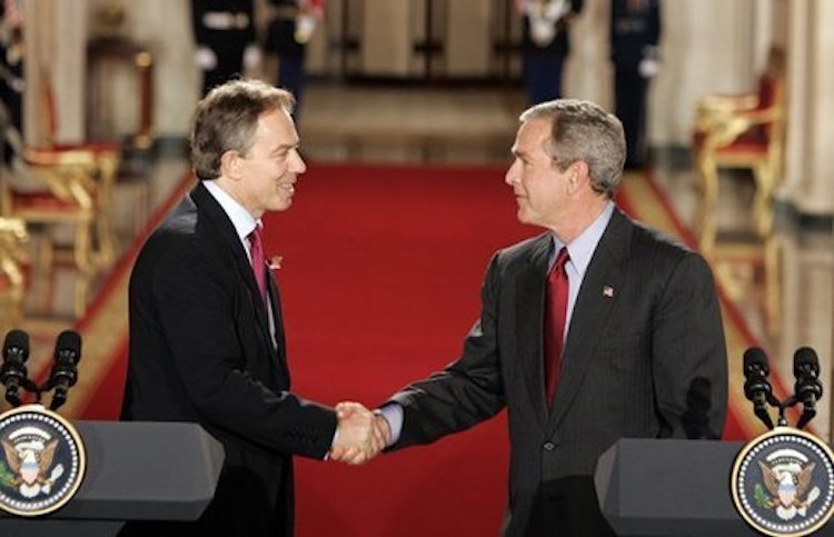 Photo: British Prime Minister Tony Blair and US President George W. Bush shake hands after their press conference in the White House on 12 November 2004. From the start of the War on Terror in 2001, Blair strongly supported Bush's foreign policy, participating in the 2001 invasion of Afghanistan and 2003 invasion of Iraq. Credit: Wikimedia Commons.