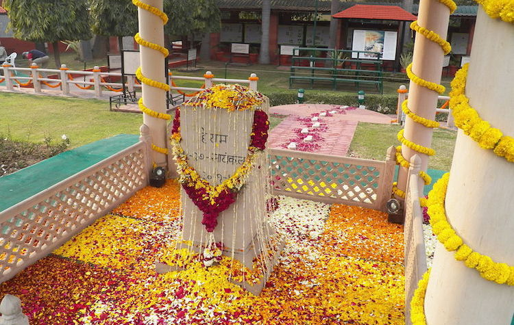 Photo: Memorial where Gandhi was assassinated in 1948. His stylised footsteps lead to the memorial. CC BY-SA 3.0