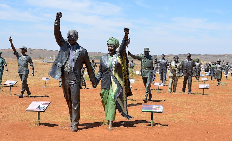 "Photo: A bronze statue of Nelson and Winnie Mandela, The Long March to Freedom, at Maropeng, 480 kilometres from Johannesburg. Mandela said: ""To deny people their human rights is to challenge their very humanity."" Source: Wikimedia Commons. CC BY-SA 4.0"