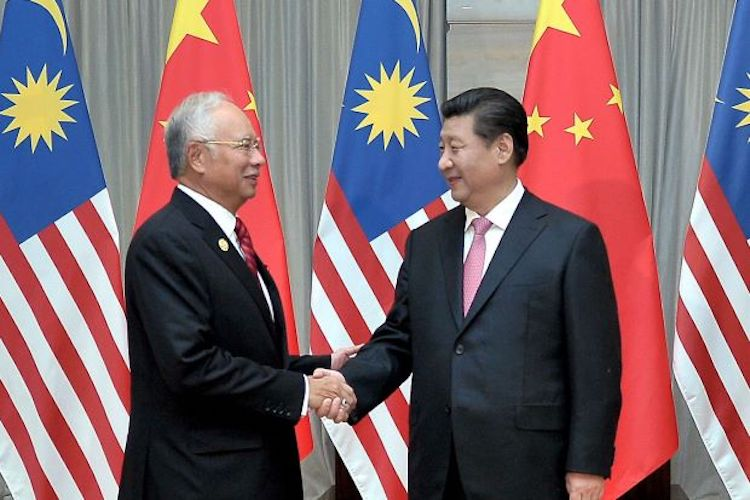 Photo: Malaysian Prime Minister Najib Razak meets with Chinese President Xi Jinping (right) in Beijing in May 2017, one year before he lost the election. Credit: The Mole Magazine