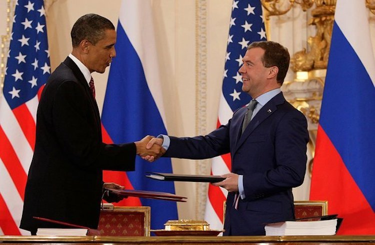 "Photo: U.S: President Barack Obama and Russian counterpart Dmitry Medvedev after signing the ""New START"" treaty on 8 April 2010 in Prague. CC BY 4.0."