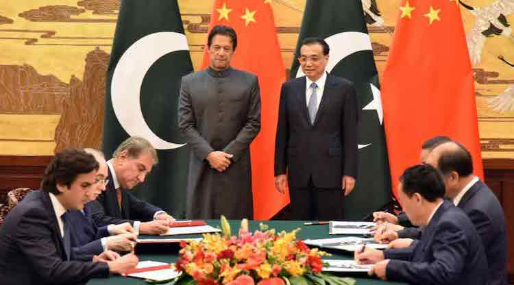 Photo: Prime Minister Imran Khan and Premier Li Keqiang signed important MOUs during the former's first visit to China early November.  Credit: China-Pakistan Economic Corridor (CPEC).