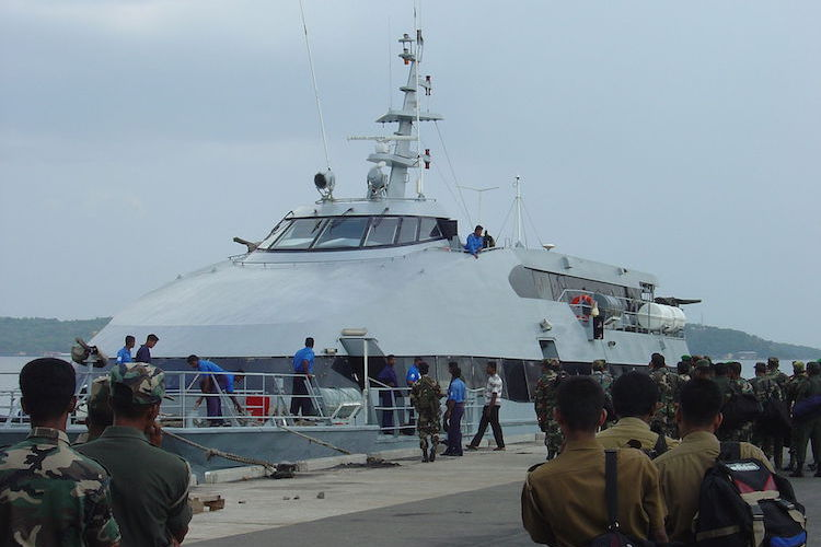 Photo: Sri Lanka troop transport catamaran in strategically located deep-water Trinconalee harbor in August 2004. Credit: Wikimedia Commons.