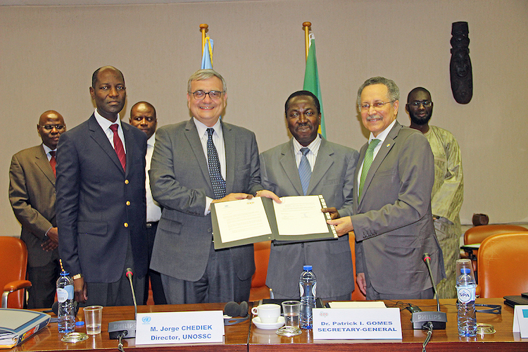 Photo: Signing ceremony for exchange of letters between UNOSSC and ACP Secretariat.