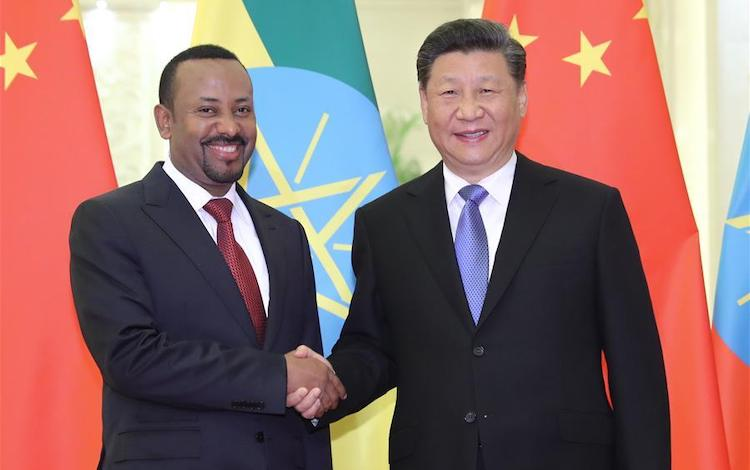 Photo: Chinese President Xi Jinping (R) meets with Ethiopian Prime Minister Abiy Ahmed Ali, who was in Beijing for the second Belt and Road Forum for International Cooperation, at the Great Hall of the People on April 24, 2019.  Credit: Xinhua/Ding Lin.