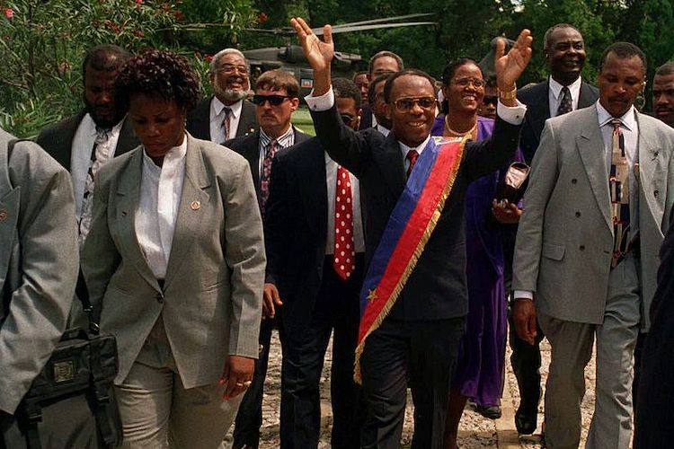Photo: Jean-Bertrand Aristide returns to Haiti, following the U.S.-led invasion in 1994 designed to remove the regime installed by the 1991 Haitian coup d'état. Source: Wikimedia Commons.