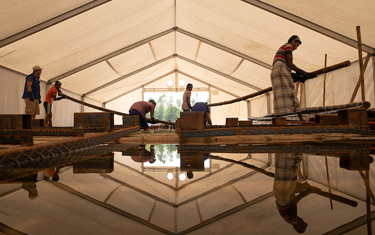 Photo: Bamboo becomes insect-resistant when soaked in a chemical solution for 12 -14 days. Credit: IOM/Abdullah Mashrif.