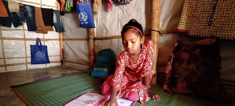 Photo: Shefuka (9) studies at home with support from her mother and teacher, while her learning centre remains closed in the Rohingya refugee camp. Credit: UNICEF | UNI340770