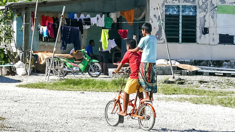 Photo: Children riding a bicycle in Tuvalu. Credit: UNDP | Silke Von Brockhausen