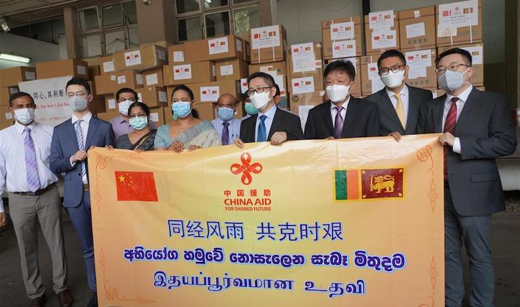 Photo:  Hu Wei (4th R), charge d'affaires of the Chinese Embassy, attends a ceremony with Sri Lankan Health Minister Pavithra Wanniarachchi (4th left front) in Colombo, Sri Lanka, April 1, 2020. China has handed over its first donation of humanitarian aid and medical supplies to Sri Lanka to strengthen the solidarity between the two countries as Sri Lanka fights the COVID-19 pandemic. Credit: Xinhua/Tang Lu