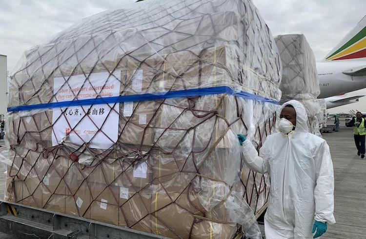 Photo: Staff members unload the medical supplies from China at the airport in Addis Ababa, Ethiopia, March 22, 2020. Credit: Xinhua