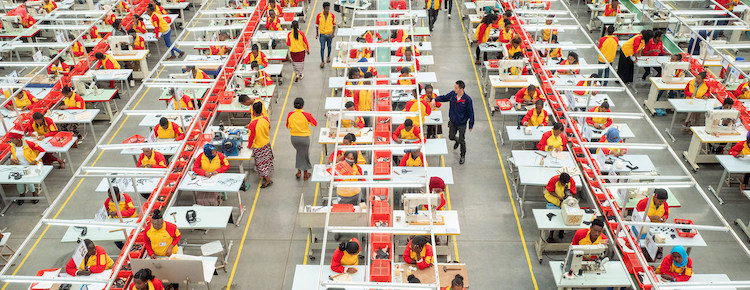 Photo: Workers at a Chinese shoe-making factory in Addis Ababa, Ethiopia. Credit: Lin Qi