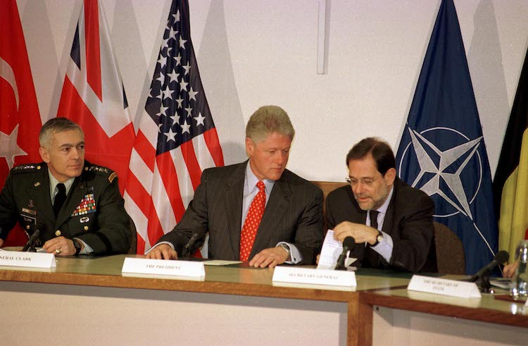 Photo: US President Bill Clinton (centre), the architect of NATO's expansion up to Russia's borders, with NATO Secretary General Javier Solana (right) and General Wesley Clark (left), the Supreme Allied Commander Europe of NATO from 1997 to 2000, at NATO headquarters. Credit: NATO.