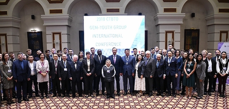 Photo: Participants of the 2018 CTBTO GEM – Youth International Conference in Astana. In the front is ATOM Project leader, Honorary Ambassador and artist Karipbek Kuyukov. Behind him: Kazakh Foreign Minister Kairat Abdrakhmanov (on the right) and CTBTO Executive Secretary Dr Lassina Zerbo (on the left). Credit: CTBTO. | Photos of Kazakh Foreign Minister Abdrakhmanov and Dr Zerbo in the text are by Katsuhiro Asagiri, IDN-INPS Multimedia Director.
