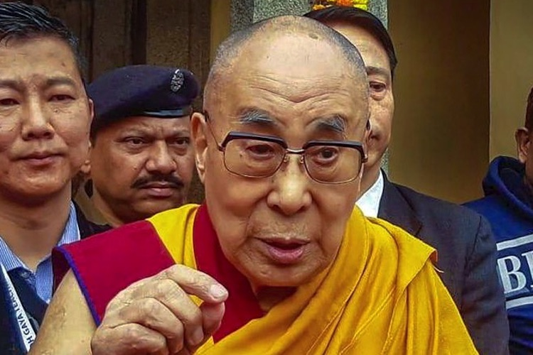 Photo: The Dalai Lama, spiritual head of the Tibetan people, interacts with the media during his visit to the Mahabodhi temple in Bodhgaya, December 2019. Credit: PTI.