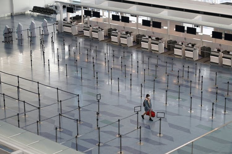 Photo: A passenger walks through an emptied check-in area at Haneda International Airport in Tokyo, Japan, March 19, 2020. Foreign visitors to Japan have plunged by 58% since the coronavirus outbreak. Credit: EPA-EFE/Franck Robichon