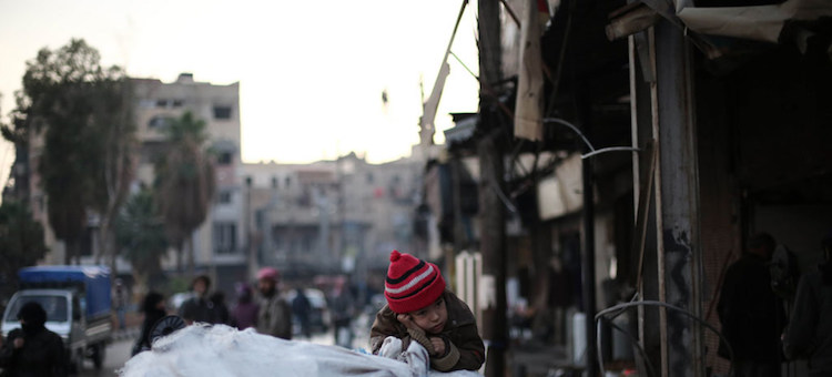 Photo: A family flees an active conflict neighbourhood in eastern Ghouta, Syria, using a cart to carry their belongings. Credit: UNICEF/Amer Al Shami.