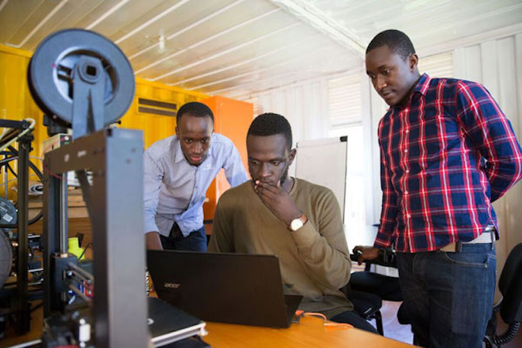 Photo: Brian Gitta (centre) has been named a finalist for the prestigious Africa Prize for Engineering Innovation. Source: Daily Monitor, Uganda.
