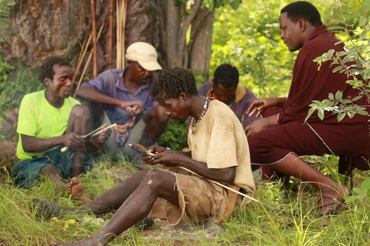 Photo: Members of the Hadzabe community in Manyara region making bows for hunting. The group is among beneficiaries of the mapping project run by the Ujamaa Community Resources Team. Credit: Goldman Environmental Prize