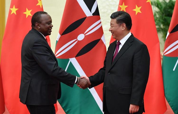 Photo: Kenyan President Uhuru Kenyatta (left) with the Chinese President Xi Jinping (right) at the Great Hall of the $3.8 billion cost of the Naivasha-Kisumu phase of the Standard Gauge Railway to be provided as part of grant financing. Credit: Xinhua/Yin Bogu.