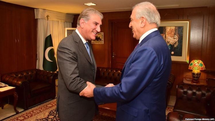 Photo: Pakistani Foreign Minister Shah Mahmood Qureshi (left) receives U.S. envoy Zalmay Khalilzad at the Foreign Ministry in Islamabad on January 18. Source: Radio Free Europe/Radio Liberty.