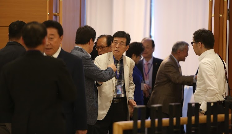 Photo: Ulaanbaatar Forum participants engaged in discussion during a break. Credit: Blue Banner.