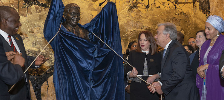 Photo: (From left) Matamela Cyril Ramaphosa, the President of South Africa; María Fernanda Espinosa, the President of the General Assemby; and Secretary-General António Guterres unveil the statue of Nelson Mandela at the UN Headquarters in New York. UN Photo/Cia Pak