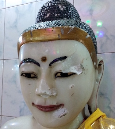 A a marble statue of the Buddha from Ramu Simar Vihar that was attacked with hammers. Credit: Kalinga Seneviratne | IDN-INPS.