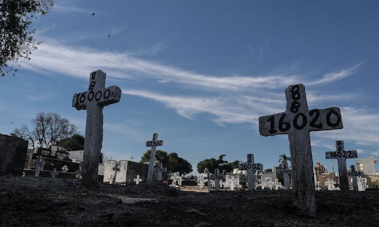 Photo: Mass graves – such as these in northern Rio de Janeiro – have been needed to bury the dead during the pandemic. Credit: EPA-EFE