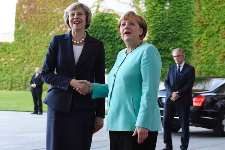 Photo: British Prime Minister Theresa May (left) and German Chancellor Angela Merkel (right). Credit. The Mirror