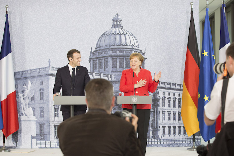 Photo: Europe needs key decisions to be made in the near future to give the people answers to the major questions of our time, agreed German Chancellor Angela Merkel and French President Emmanuel Macron in a press conference at the Humboldt Forum in the Berlin Palace in April 2018. Credit: Bundesregierung/Steins