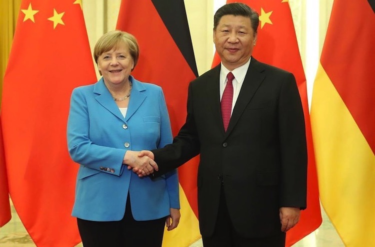Photo: German Chancellor Angela Merkel with Chinese President Xi Jinping in Beijing on May 24, 2018 at which they discussed intensifying German Chinese relations. Credit: Xinhua/Liu Weibing