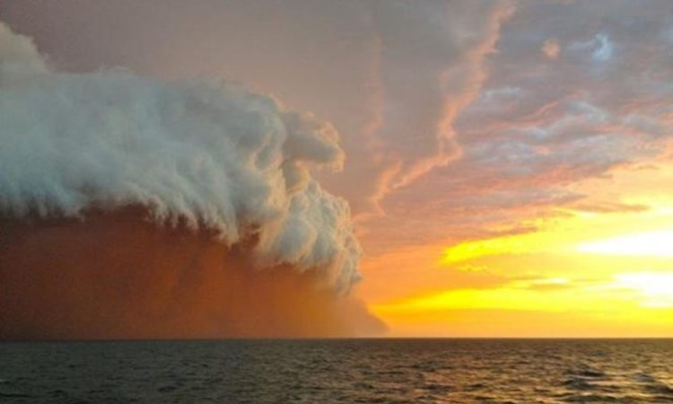 Photo: Huge massive red sandstorm. Credit: Strange Sounds