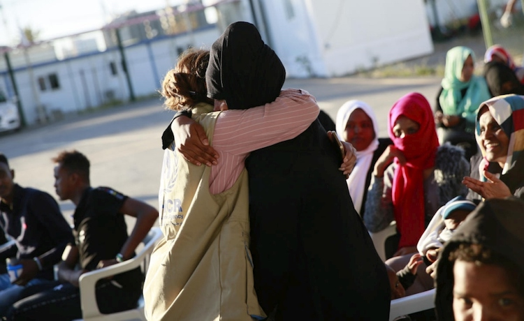 Photo: Relieved and happy to be released from detention, a refugee hugs UNHCR staff as they meet at the Gathering and Departure Facility in Tripoli, Libya.  © UNHCR/Mohamed Alalem.