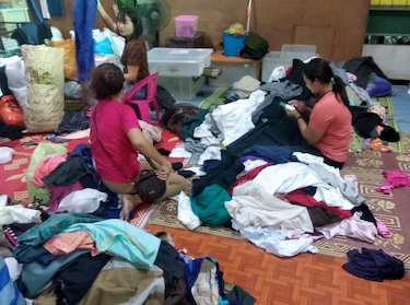 Secondhand clothes being sold at a Buddhist supermarket in Santi Asoke community in the north-eastern outskirts of Bangkok.