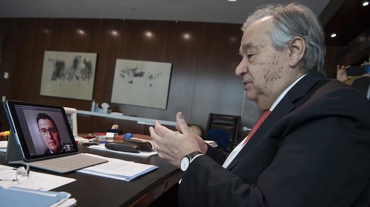 "Photo: Secretary-General António Guterres speaks online with a former Syrian refugee, cardiologist Dr. Heval Kelli, at the launch of a new policy brief on the impact of COVID-19 on ""People on the Move."" UN Photo/Eskinder Debebe"