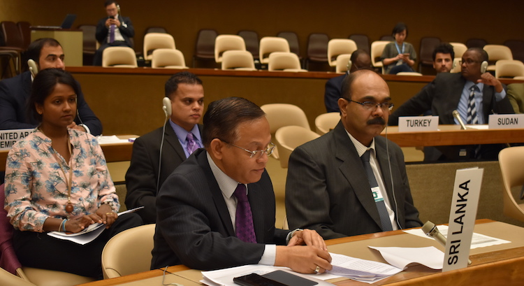 Photo: Ambassador A.L.A Azeez, Permanent Representative of Sri Lanka to the UN in Geneva, addressing the Eighth Meeting of Convention on Cluster Munition, accompanied by his team. Credit: Permanent Mission of Sri Lanka to the UN in Geneva.