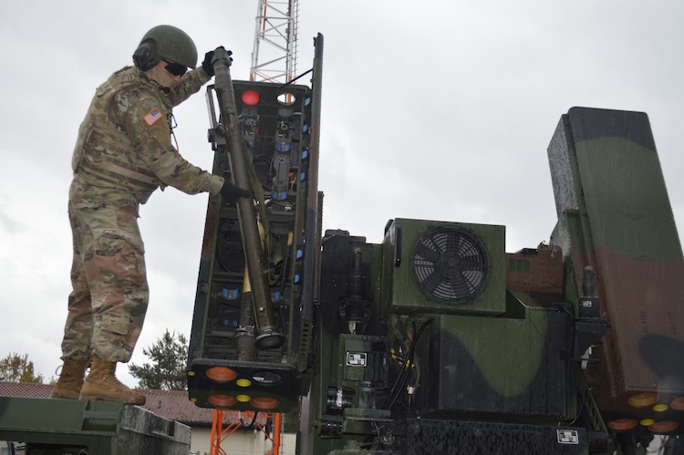 Photo: An air and missile defense crew member loads a Stinger missile onto an Avenger short-range air defense missile system on Shipton Kaserne, Ansbach, Germany, during training, April 30, 2020. Credit: Dani Johnson, U.S. Army