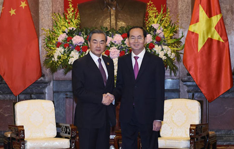 Photo: On April 1, 2018 local time, President Tran Dai Quang of Vietnam (right) met in Hanoi with State Councilor and Foreign Minister Wang Yi (left), who was paying an official visit to Vietnam.