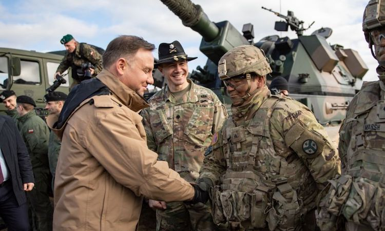 Photo: Polish president Andrzej Duda meets with soldiers assigned to the Tennessee Army National Guard's 2nd Squadron, 278th Armored Cavalry Regiment's Task Force Raider, during a visit to Bemowo Piskie Training Area, Poland, March 6, 2019. Credit: SARAH KIRBY/U.S. ARMYring troops from Germany to Poland.