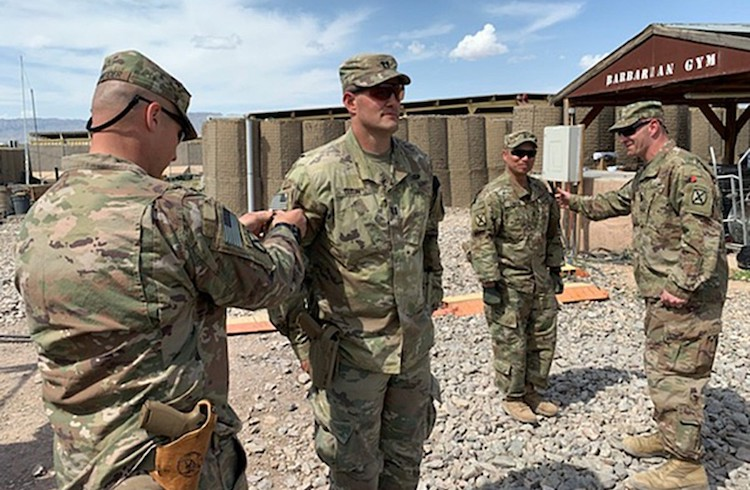Photo: Capt. Matthew Dixon, who deployed with the 1st Battalion, 87th Infantry of the 10th Mountain Division, receives a combat patch during his deployment to Afghanistan during the spring of 2020. U.S. ARMY