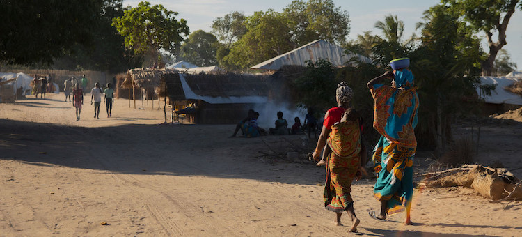 Photo: Two women walk at an IDP camp in Cabo Delgado, Mozambique, after brutal attacks in northern Mozambique. Credit: UNICEF/Mauricio Bisol.